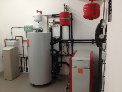 Oil powered boiler with solar water and water softener, Menorca